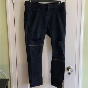 Black rip and zipper jeans